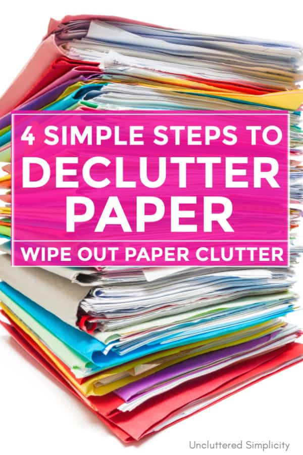 stack of colorful file folders filled with paper decluttering paperwork