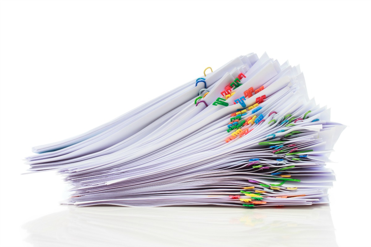 stack of paper with colorful clips organizing paperwork