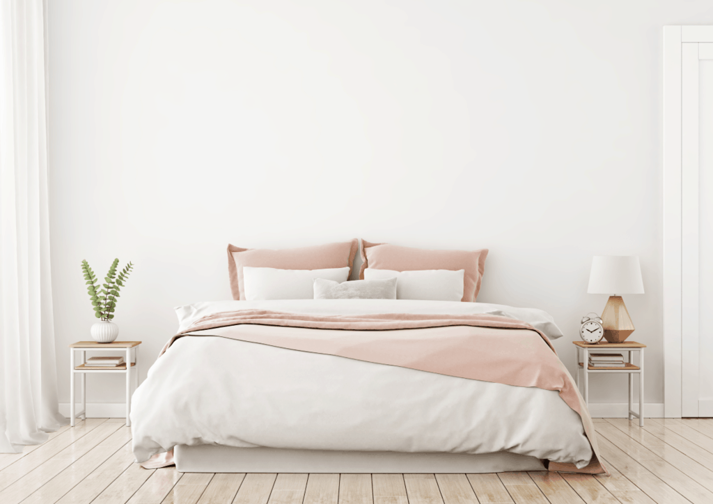 Minimalist bedroom with neatly made bed-Things People with Clean Houses Do Every Day