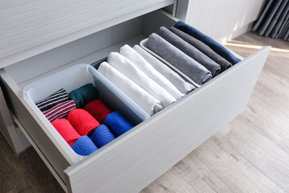 clothes neatly folded and stored in a drawer