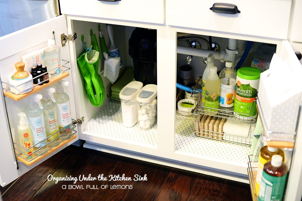 organizing under the kitchen sink with command hooks