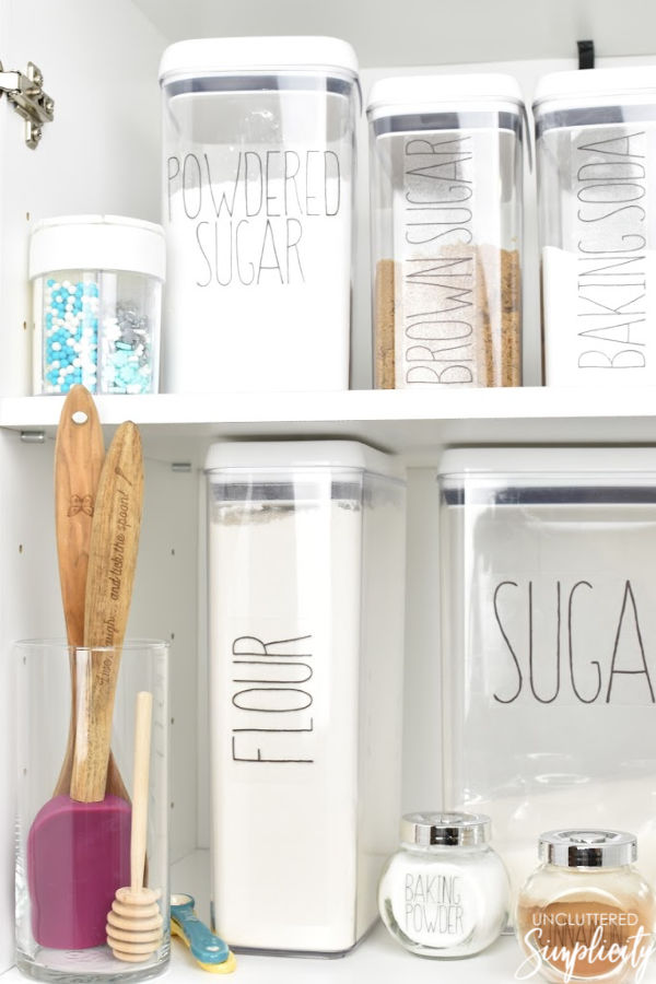 pantry organized with clear, labeled food storage containers