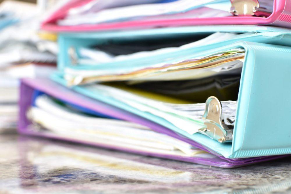 stack of colorful school binders