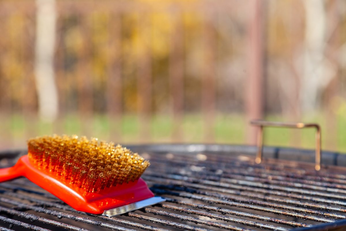 things you forget to clean-red scrub brush on outdoor grill